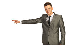 Happy executive man pointing Royalty Free Stock Photos