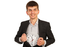 Happy executive man showing clock Royalty Free Stock Photo