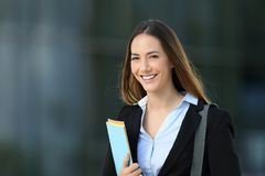 Happy executive posing looking at you. Standing alone on the street Royalty Free Stock Photo