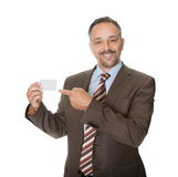 Happy executive showing a blank business card Stock Images