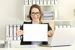 Happy executive showing a blank paper. To camera at office Royalty Free Stock Photo