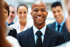 Happy executive with team support Royalty Free Stock Photography