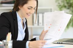 Happy executive managing different documents at office Royalty Free Stock Photography