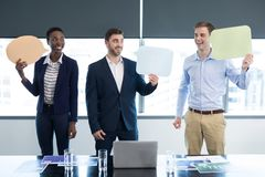 Happy executives holding speech bubble. In office stock image