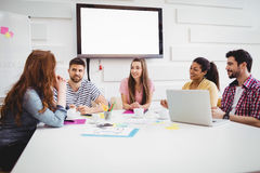 Happy executives during meeting in creative office Stock Photography