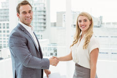 Happy executives shaking hands Stock Image