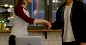 Executives shaking hands in office cafe 4k. Happy executives shaking hands in office cafe 4k stock footage