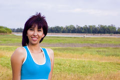 Happy exercise healthy woman. Happy healthy woman half body in nature Stock Photography