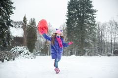 Happy exited girl with Valentine heart balloons outdoor. Valentine`s day concept. Copy space. royalty free stock image
