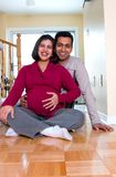 Happy Expectant Couple At Home Stock Images