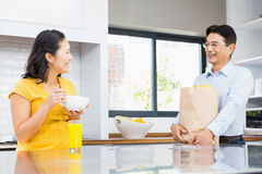 Happy expectant couple in the kitchen Stock Images