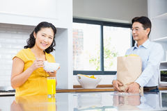 Happy expectant couple in the kitchen Royalty Free Stock Images