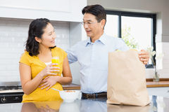Happy expectant couple in the kitchen Royalty Free Stock Image