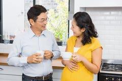 Happy expectant couple talking Stock Photos