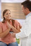 Happy expectant mother at doctor Stock Images