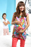 Happy expectant mother and jealous daughter Stock Photo