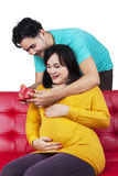 Happy expectant woman getting a gift Royalty Free Stock Photos