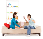 Happy expecting parents at home Stock Images