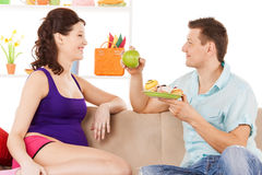 Happy expecting parents at home Stock Photography