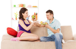 Happy expecting parents at home Stock Image