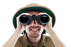 Happy explorer looking through binoculars Stock Images