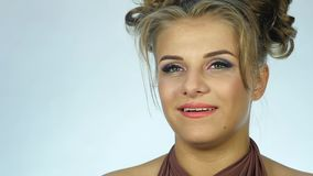 Happy expression woman`s face, different emotions. girl flirts slow motion stock video