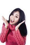 Happy expressiopn of surprise isolated in white. Beautiful woman is expressing her surprise happily wearing pink jumper isolated in white Royalty Free Stock Photos