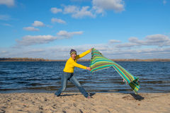 Happy expressive woman having fun, catches the wind, playing wit Royalty Free Stock Photo
