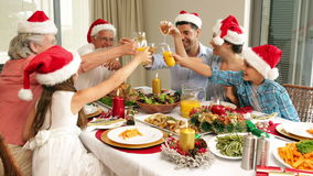 Happy extended family at the christmas dinner table Royalty Free Stock Photos