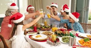 Happy extended family at the christmas dinner table Stock Photography