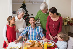 Happy extended family at christmas time Stock Photo