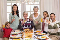 Happy extended family at christmas toasting at camera Royalty Free Stock Image