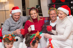Happy extended family enjoying coffee at christmas time Stock Images