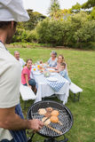 Happy extended family having a barbecue being cooked by father i Stock Photos