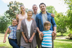 Happy extended family standing at park Royalty Free Stock Image