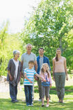 Happy extended family walking in park Stock Photography