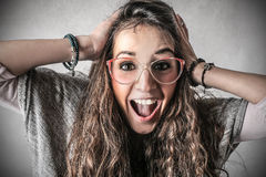 Happy exulting woman. Young beautiful woman with a cheerful expression Royalty Free Stock Images