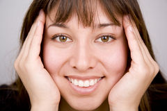 Happy Face. Young woman expressing positivity and happiness Royalty Free Stock Images