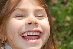 Happy face. Little girl with a happy smile on her face outdoors Stock Images