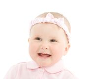 Happy face of baby girl with bowknot on head. Isolated on white background stock photography