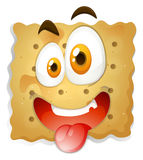 Happy face on biscuit Stock Images
