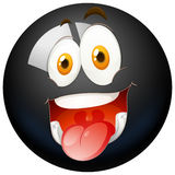 Happy face on black ball Stock Image