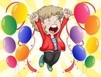 A happy face of a boy with balloons around him Stock Images
