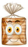 Happy face on bread Royalty Free Stock Photography