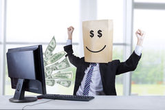 Happy face of businessman looking money 1 royalty free stock image