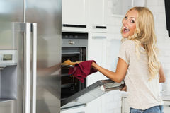Happy face commercial girl cooking Royalty Free Stock Images