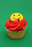 Happy Face Cupcake Royalty Free Stock Photos