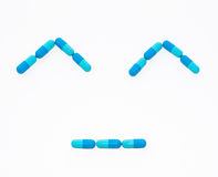 Happy face from drug capsule. Royalty Free Stock Photography
