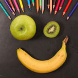Happy face with fruits Royalty Free Stock Image