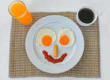 Happy Face Frying Eggs for breakfast isolate on white Royalty Free Stock Image